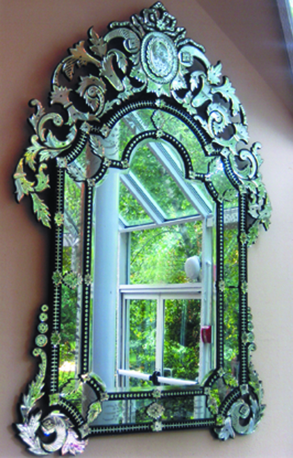 A Venetian mirror from the terrace room.