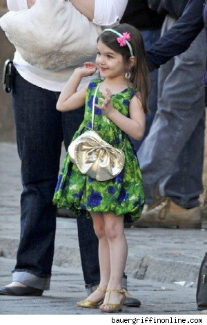 Suri was spotted carrying a tiny metallic Salvatore Ferragamo