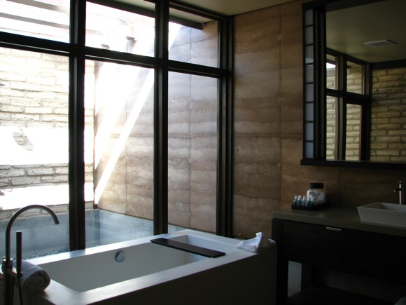 Tub with Glimpse of Outdoor Shower