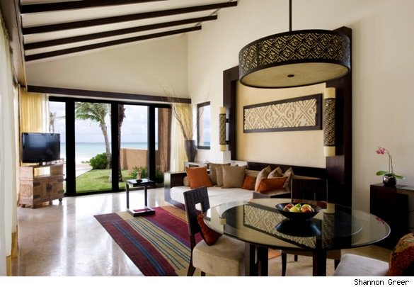 The living area of the three-bedroom beachfront pool villa.