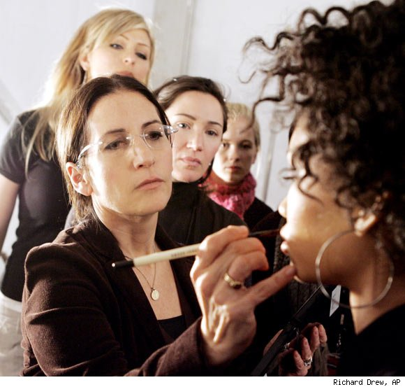 Bobbi Brown applying cosmetics