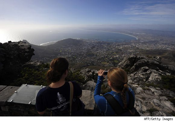 Tourists take pictures from the Table Mountain cableway arrival station.