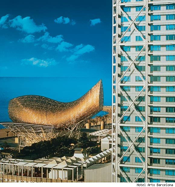 A view of the Hotel Arts Barcelona with Frank Gehry's famous Peix d'Or (fish) sculpture in the background.