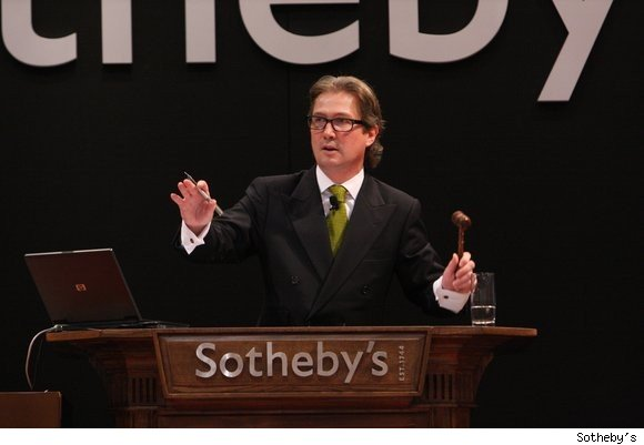 Jamie Ritchie, auctioneer, presiding over a Sotheby's wine auction.
