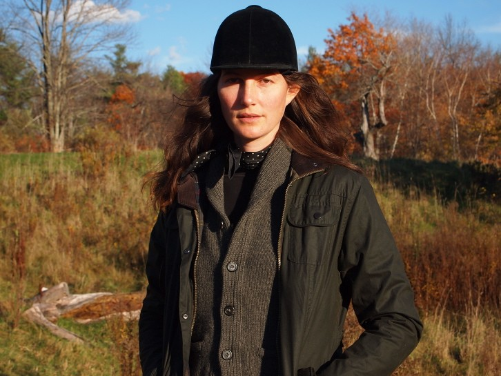 Jacket by Barbour; sweater and scarf by Ralph Lauren; vintage riding hat