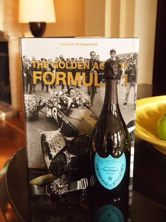 'The Golden Age of Formula 1' (teNeues); Dom Perignon Warhol edition; Persol sunglasses; Freemans Sporting Club watch.