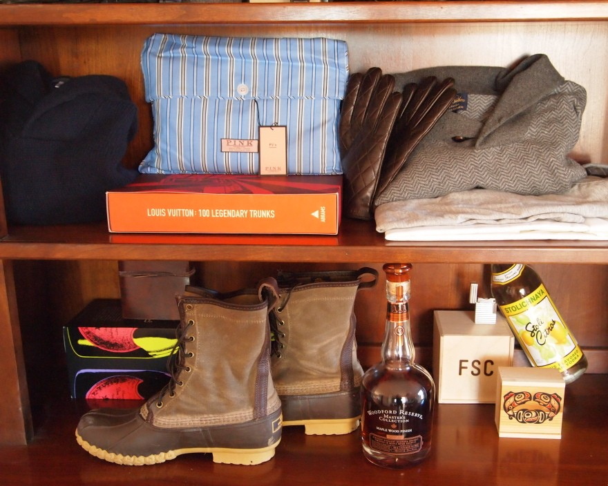 From top right: Thos. Pink gloves; Brooks Bros. sweater; Dunning sportswear; L.L. Bean Signature boots; Woodford Reserve bourbon