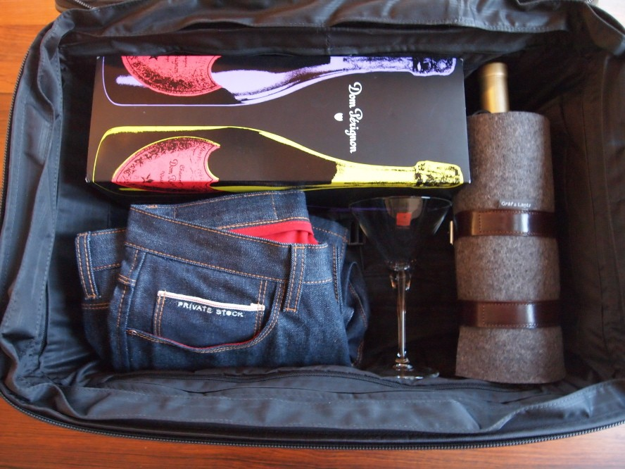 Tumi Alpha case; Dom Perignon Tribute to Andy Warhol edition; Private Stock jeans; Graf & Lantz Quiver wine carrier w/ Robert Mo