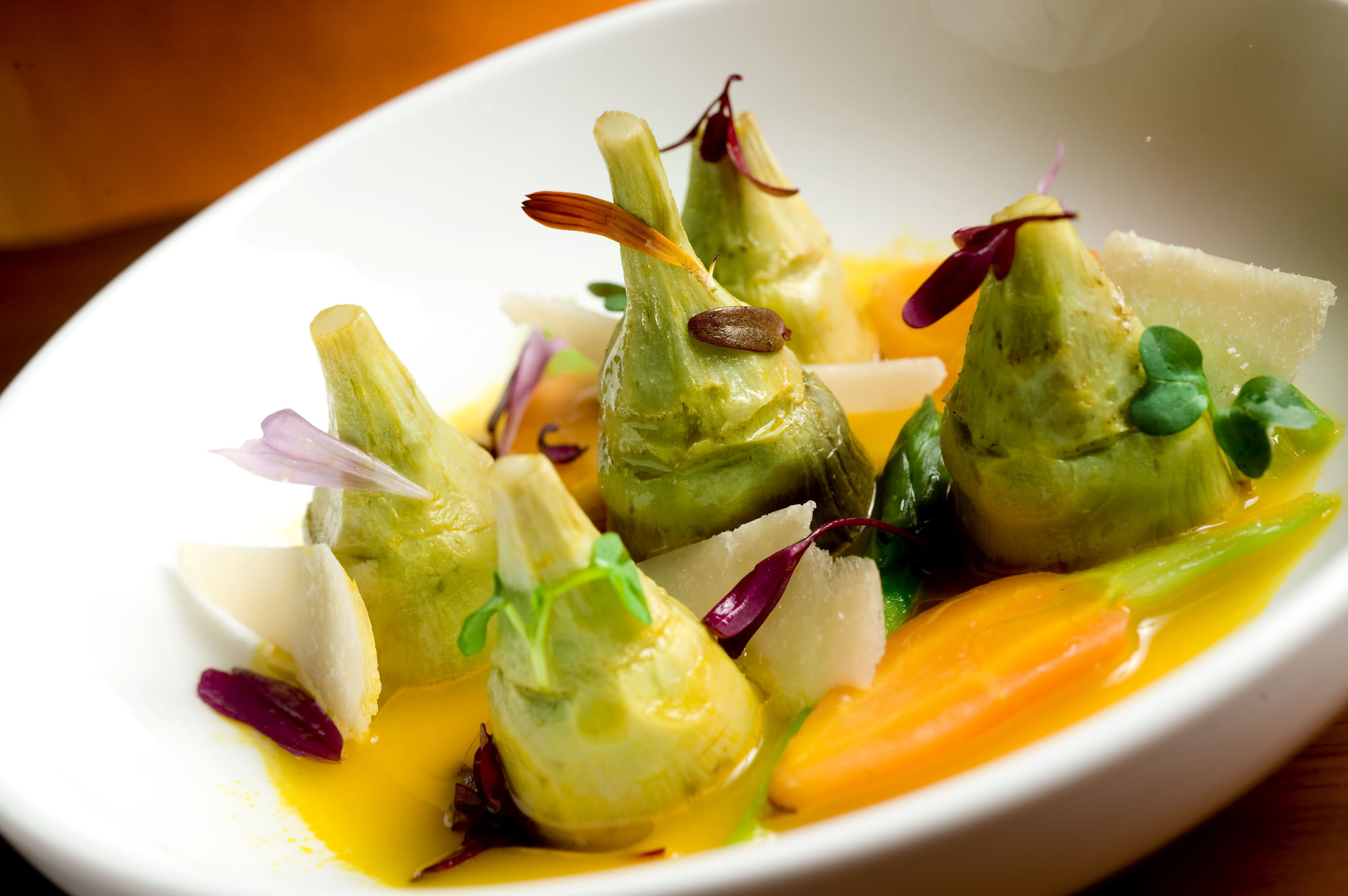 Artichoke Barigoule with asparagus, baby carrots and basil