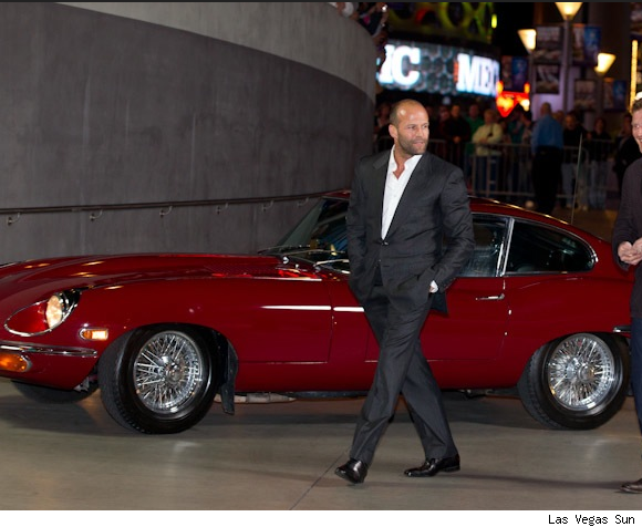 Jason Stratham Arrives at 'Mechanic' Premiere in Iconic Jaguar E-type