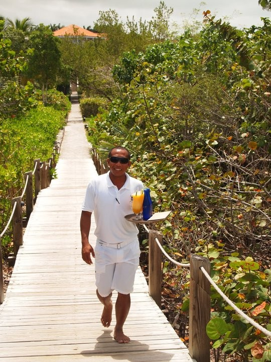 Carrying drinks to the beach at Parrot Cay