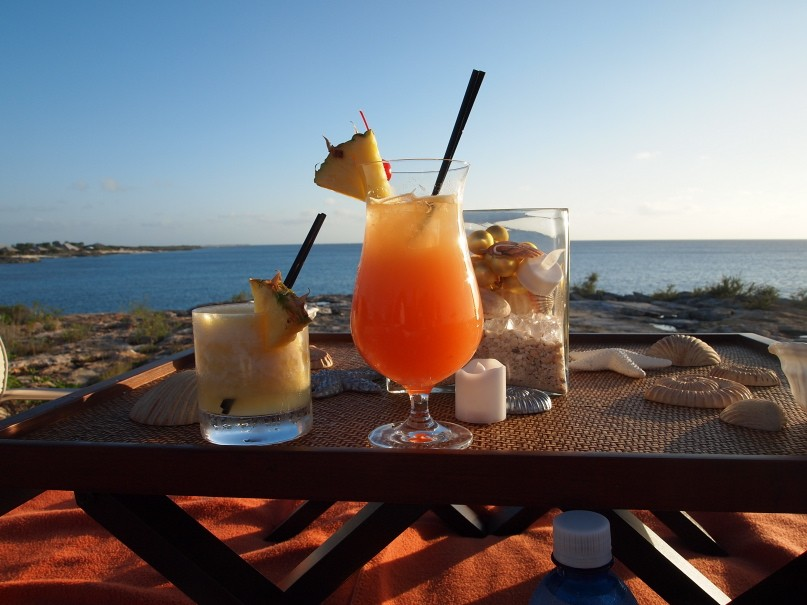 Sunset sala cocktails overlooking the ocean at Amanyara