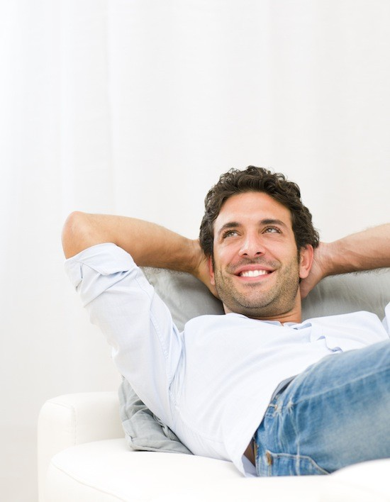 man relaxing, happy guy on couch