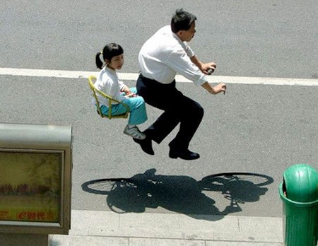 invisible bikes, man and daughter