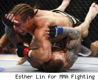 Urijah Faber defeats Eddie Wineland at UFC 128.
