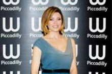 Blue streak: Dannii Minogue turns author in a dip-dyed dress