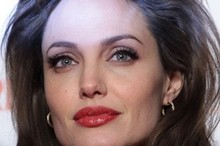 Angelina Jolie vamps it up with red lips in Rome