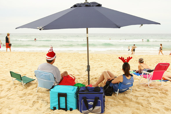 Couple celebrating Christmas on the beach
