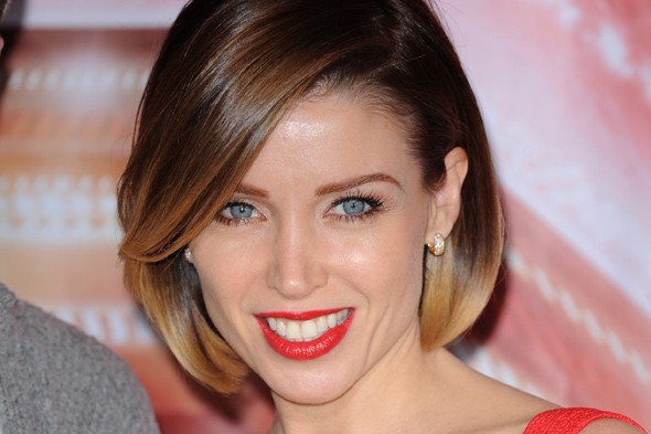 Headshot of Dannii Minogue wearing red lipstick