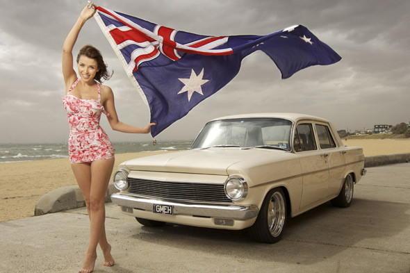 Dannii Minogue with Australian flag on Bondi beach