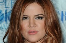 Khloe Kardashian shows off a red hot 'do at People's Choice Awards