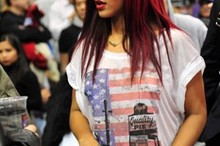 Rihanna debuts poker straight hair at basketball game