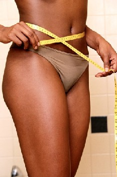 woman-tape-measure-measuring-waist