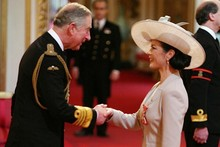 Catherine Zeta Jones is super-stylish as she receives CBE