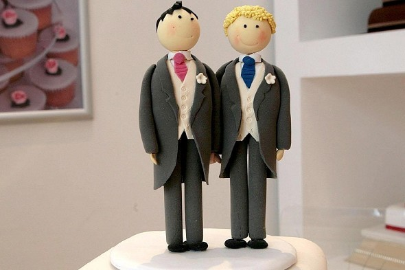 Two male wedding cake toppers