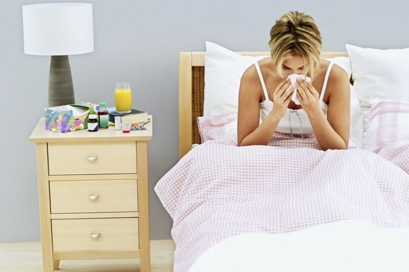 woman-in-bed-sneezing-common-cold
