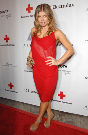 Fergie wearing a red dress at a Red Cross event
