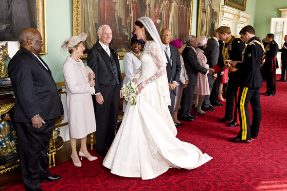 Kate Middleton greets distinguished guests inside Buckinham Palace