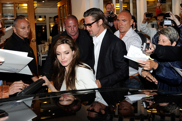 Brad Pitt and Angelina Jolie are mobbed by fans and photographers in Cannes.