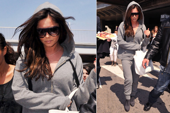 Cheryl Cole arrives in Cannes in grey hooded tracksuit