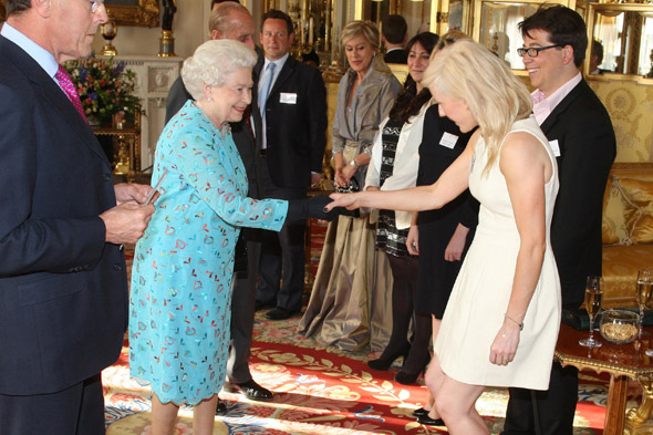 Ellie Goulding meets the Queen at Buckingham Palace