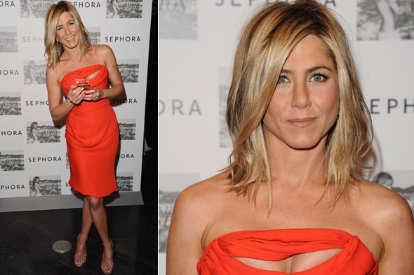 Jennifer Aniston wows in bright orange Vivienne Westwood dress at perfume launch in New York