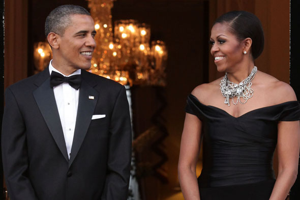The Obamas celebrate their last night in the UK with a formal dinner at Winfield House.