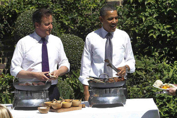 David Cameron and Barack Obama dish up the meat at the Downing Street BBQ