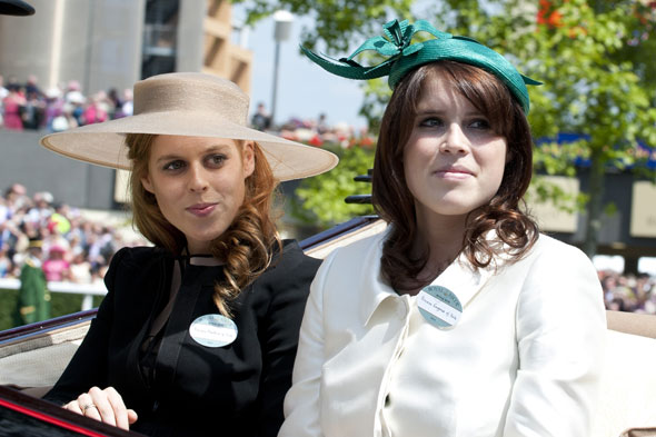 Princesses on parade: Beatrice and Eugenie arrive at Ascot this afternoon.