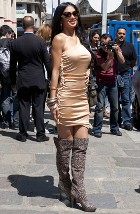 Nicole Scherzinger wearing thigh-high leopard boots in Paris