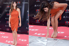 Penelope Cruz receives Madrid Walk of Fame star in orange Roksanda frock