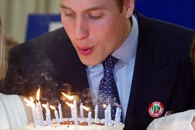 Prince William blows out candles