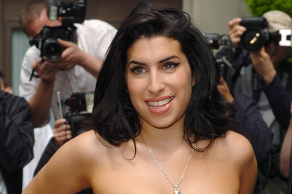 Fans send Amy Winehouse's album Back to Black back to the top of the charts following her sudden death on Saturday
