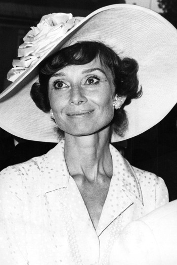 Hepburn donned a wide brimmed hat and that famous smile for a wedding