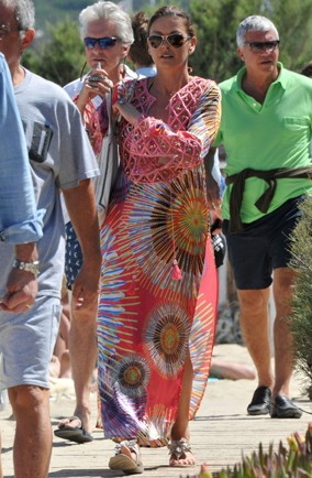 Catherine Zeta-Jones wearing a bright printed kaftan on holiday in St Tropez with husband Michael Douglas