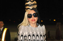 Lady Gaga colour coordinates her beehive hair and outfit as she jets into Taiwan