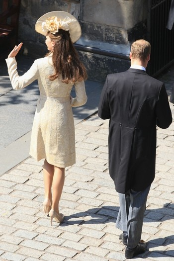 The Duke and Duchess of Cambridge wave to the crowds on the Royal Mile