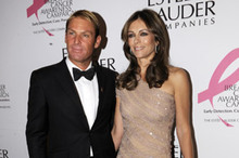 Liz Hurley wears feathers and beads for Estée Lauder charity ball
