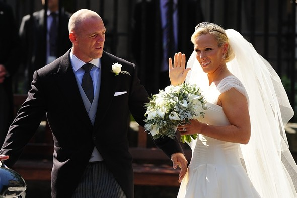 Mike and Zara wave to the crowds after their wedding