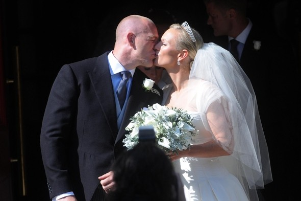 Pucker up! Mike and Zara enjoy a kiss as a married couple